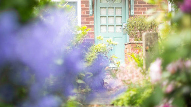 Medium crop cottage blue door